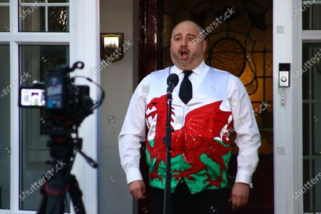 Stock Photo of Wynne Evans hosts a live broadcast of The Welsh National Anthem on social media in appreciation of the NHS and all the care and key workers during the Covid19 coronavirus pandemic.
