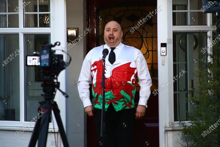 Stock Picture of Wynne Evans hosts a live broadcast of The Welsh National Anthem on social media in appreciation of the NHS and all the care and key workers during the Covid19 coronavirus pandemic.