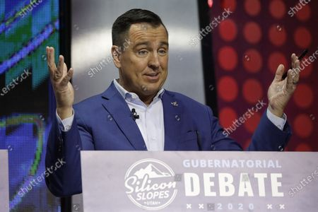 """Former Utah House Speaker Greg Hughes speaks during a debate for Utah's 2020 gubernatorial race, in Salt Lake City. Hughes chose an elected official from southern Utah as his running mate in the governor's race . Hughes, a Republican, pointed to Victor Iverson's efforts to keep the tax rate low and rainy-day funds robust in Washington County, calling him a """"proven leader with a commitment to conservative principles"""