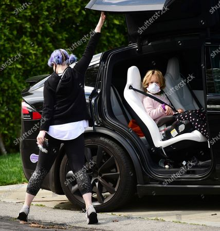 Kelly Osbourne wears a face mask out with her neice, Pearl Osbourne.