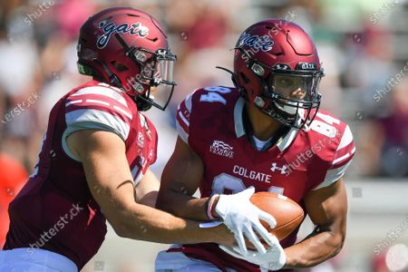 Colgate Raiders quarterback Jake Froschauer #17 hands the ball to wide receiver Nick Draught #84 against the Maine Black Bears during an NCAA football game on Saturday, Sept., 21, at Andy Kerr Stadium in Hamilton, New York. Maine won 35-21