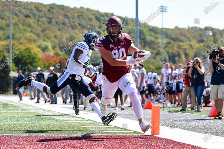 Colgate Raiders tight end Nick Diaco #80 runs into the end zone for a touchdown against the Maine Black Bears during an NCAA football game on Saturday, Sept., 21, at Andy Kerr Stadium in Hamilton, New York. Maine won 35-21