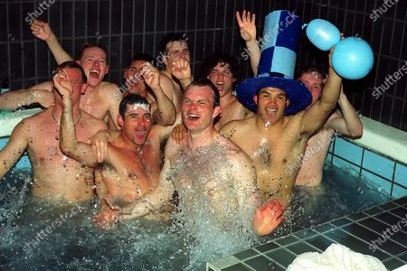 Wycombe's Jason Cousins, Keith Scott and Hakan Hayrettin lead the singing in the bath in the Wembley dressing room as they celebrate winning the FA Trophy during Runcorn vs Wycombe Wanderers, Vauxhall FA Trophy Final Football at Wembley Stadium on 9th May 1993