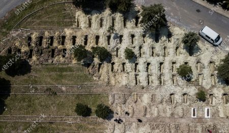 An aerial picture taken by drone shows newly dug graves by Istanbul Municipality workers for possible victims of the pandemic COVID-19 at Kilyos cemetery in Istanbul, Turkey 14 April 2020. Turkish President Recep Tayyip Erdogan announced on 13 April 2020, that there will be a two-day curfew on 18 and 19 April in 31 metropolitan provinces due to the ongoing pandemic of the Covid-19 disease caused by the SARS-CoV-2 coronavirus.