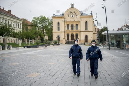 Police officers patrol in Pecs, Hungary, 14 April 2020. The Hungarian government has extended the lockdown implemented to curb the spread of the novel coronavirus pandemic. Police are tasked to ensure that people comply with social distancing and the stay-at-home order. Countries around the world are taking increased measures to stem the widespread of the SARS-CoV-2 coronavirus wh?ich causes the Covid-19 disease.