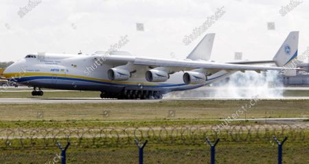 The world's largest cargo plane, the Soviet-made Antonov An-225 Mrija, lands in Warsaw's Frederic Chopin airport with a $15 million worth cargo of protective masks, outfits and visors that were bought by Poland's state-owned companies for hospitals fighting the coronavirus spread, in Warsaw, Poland, . The new coronavirus causes mild or moderate symptoms for most people, but for some, especially older adults and people with existing health problems, it can cause more severe illness or death