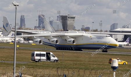 Stock Picture of The world's largest cargo plane, the Soviet-made Antonov An-225 Mrija, lands in Warsaw's Frederic Chopin airport with a $15 million worth cargo of protective masks, outfits and visors that were bought by Poland's state-owned companies for hospitals fighting the coronavirus spread, in Warsaw, Poland, . The new coronavirus causes mild or moderate symptoms for most people, but for some, especially older adults and people with existing health problems, it can cause more severe illness or death