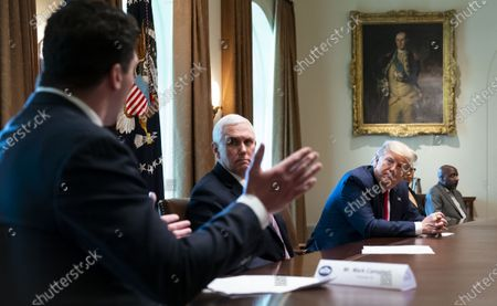 Former football player Mark Campbell from Michigan makes remarks about his bout with Coronavirus as US President Donald J. Trump and Vice President Mike Pence looks on as they meet with recovered COVID-19 patients in the Cabinet Room at the White House, Washington, DC, USA, 14 April 2020.