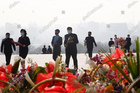 People visit the Mansu Hill to lay flowers to the bronze statues of late leaders Kim Il Sung and Kim Jong Il on the occasion of the 108th birth anniversary of Kim Il Sung in Pyongyang, North Korea