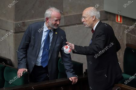 Activist of the pro-life organization Mariusz Dzierzawski (L) and one of the far-right Confederation leaders Janusz Korwin-Mikke (R) takes part in the parliamentary debate on the abortion law at the Polish Parliament in Warsaw, Poland, April 15, 2020. The Polish Sejm (lower house) has begun a debate on a civic project tightening the abortion law and amending the hunting law to allow children to take part in the hunt if their parents agree.