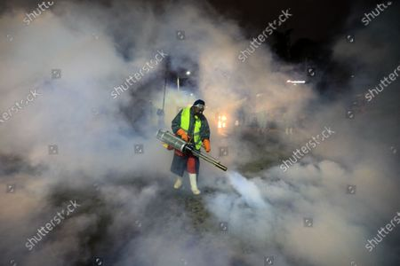 A member of the Sonko Rescue Team, an NGO founded by Nairobi Governor Mike Sonko, uses a smoke machine to spray streets and surfaces as they conduct a fumigation exercise during curfew at a local city market and its main streets in order to fight the spread of the COVID-19 coronavirus pandemic in Nairobi, Kenya, 15 April 2020. Countries around the world are taking increased measures to stem the widespread of the SARS-CoV-2 Coronavirus causing the Covid-19 disease.