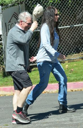 Madeleine Stowe and Brian Benben go for a walk in Pacific Palisades.