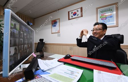 Chun Yong-jae, head of Yongsan Elementary School, greets his students as online classes for middle and high school freshmen and juniors and elementary school students in grades four through six began nationwide; in Seoul, South Korea, 16 April 2020. South Korea started the new school year in stages, more than a month later than usual due to the coronavirus pandemic, beginning with online classes for middle and high school senior students on 09 April.
