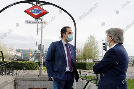 Stock Image of Madrid's regional Vicepresident, Ignacio Aguado (L), chats with regional Minister of Transport, Angel Garrido (R), during their visit to Ifema metro station in Madrid, Spain, 16 April 2020, where new protective screens have been installed to avoid coronavirus spread. Countries around the world are taking increased measures to stem the widespread of the SARS-CoV-2 coronavirus which causes the COVID-19 disease.