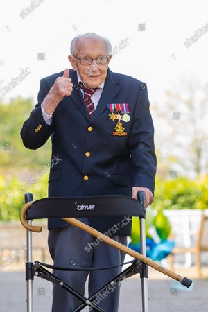99-year-old British veteran Captain Tom Moore reacts after completing the 100th length of his back garden in Marston Moretaine, Bedfordshire, Britain, 16 April, 2020. Captain Tom Moore has raised over £12 million for Britain's National Health Service (NHS) and has received donations to his fundraising challenge from around the world.