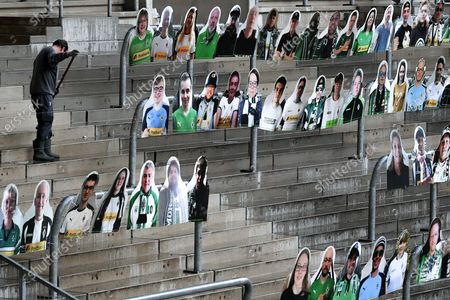 Cardboard cutouts showing supporters of German Bundesliga's football club Borussia Moenchengladbach are installed on the stands at Borussia Park stadium in Moenchengladbach, Germany, 16 April 2020. Supporters of Borussia Moenchengladbach wanted to contribute to a better atmosphere during 'ghost games' in the German Bundesliga. The German government and local authorities have heightened measures to stem the spread of COVID-19. The federal and state conference on the coronavirus crisis had confirmed that all upcoming major events would be suspended until 31 August 2020.