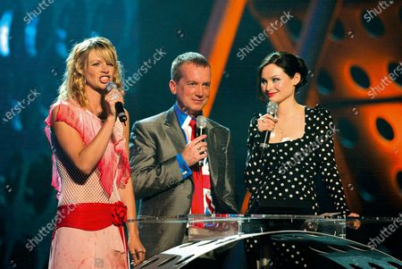 Stock Image of Hosts Zoe Ball and Frank Skinner with Sophie Ellis Bexter presenter of the British Pop Act award during the The 22nd BRIT Awards Show, Earls Court 2, London