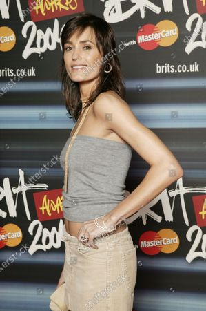 Yasmin Lebon attends the red carpet at The 24th BRIT Awards 2004 with Mastercard, Earls Court Exhibition Centre, London