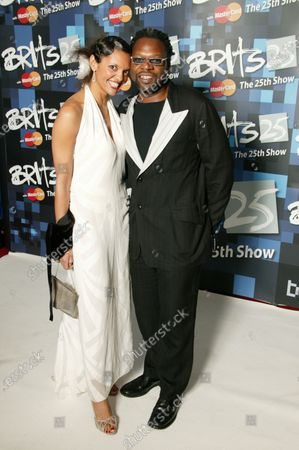 Efua Baker and Jazzy B attend The 25th BRIT Awards 2005 with Mastercard, Earls Court Exhibition Centre, London