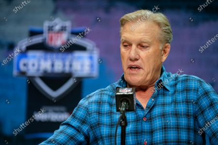 Denver Broncos president of football operations and general manager John Elway speaks during a press conference at the NFL football scouting combine in Indianapolis. Elway has selected a defensive player with his first draft pick six times in his nine drafts