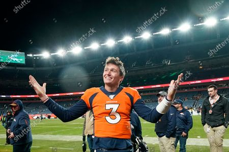 """Denver Broncos quarterback Drew Lock gestures after an NFL football game against the Oakland Raiders in Denver. While stressing that Lock has """"a long way to go"""" after spending the first half of his rookie season on injured reserve with a thumb injury, Denver Broncos president of football operations and general manager John Elway said he feels he's finally found a worthy successor to Peyton Manning. """"Now is the fun part of trying to fill around him,"""" Elway said"""