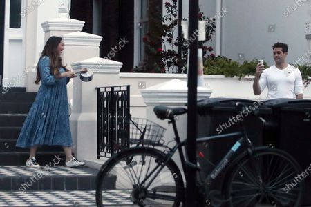 Exclusive - Kelly Brook and Jeremy Parisi clap for carers outside her home.