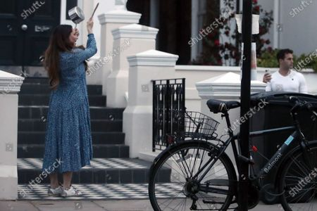 Exclusive - Jeremy Parisi and Kelly Brook clap for carers outside her home.