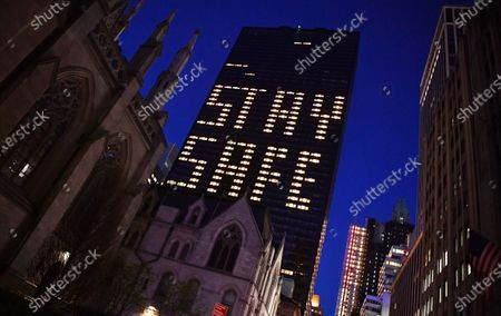 Lights on Lotte New York Palace hotel are lit to spell 'Stay Safe' due to the Coronavirus in New York City.