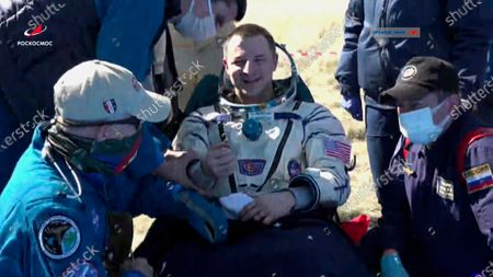 In this photo made from video footage released by Roscosmos space agency U.S. astronaut Andrew Morgan sits in a chair shortly after the landing of the Russian Soyuz MS-15 space capsule near the town of Dzhezkazgan, Kazakhstan, . An International Space Station crew has landed safely after more than 200 days in space. The Soyuz capsule carrying NASA astronauts Morgan, Jessica Meir and Russian space agency Roscosmos' Oleg Skripochka touched down on Friday on the steppes of Kazakhstan