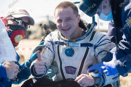 In this handout photo released by Gagarin Cosmonaut Training Centre (GCTC), Roscosmos space agency, U.S. astronaut Andrew Morgan gestures shortly after the landing of the Russian Soyuz MS-15 space capsule near Kazakh town of Dzhezkazgan, Kazakhstan, . An International Space Station crew has landed safely after more than 200 days in space. The Soyuz capsule carrying NASA astronauts Andrew Morgan, Jessica Meir and Russian space agency Roscosmos' Oleg Skripochka touched down on Friday on the steppes of Kazakhstan. (Andrey Shelepin, Gagarin Cosmonaut Training Centre