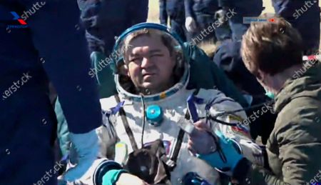 In this image made from video footage released by Roscosmos space agency Russian cosmonaut Oleg Skripochka sits in a chair shortly after the landing of the Russian Soyuz MS-15 space capsule near the town of Dzhezkazgan, Kazakhstan, . An International Space Station crew has landed safely after more than 200 days in space. The Soyuz capsule carrying NASA astronauts Andrew Morgan, Jessica Meir and Russian space agency Roscosmos' Oleg Skripochka touched down on Friday on the steppes of Kazakhstan