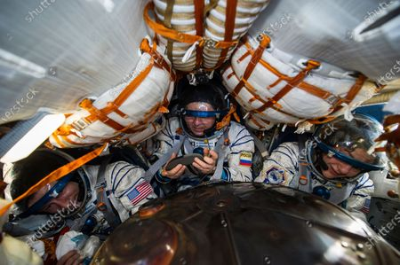 In this photo released by Gagarin Cosmonaut Training Centre (GCTC), Roscosmos space agency U.S. astronauts Andrew Morgan, left, Jessica Meir, right, and Russian cosmonaut Oleg Skripochka sit in the capsule shortly after the landing of the Russian Soyuz MS-15 space capsule near Kazakh town of Dzhezkazgan, Kazakhstan, . The International Space Station crew has landed safely after more than 200 days in space. The Soyuz capsule carrying NASA astronauts Andrew Morgan, Jessica Meir and Russian space agency Roscosmos' Oleg Skripochka touched down on Friday on the steppes of Kazakhstan. (Andrey Shelepin, Gagarin Cosmonaut Training Centre