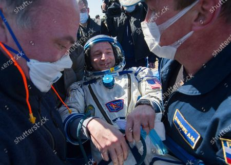 In this photo released by Gagarin Cosmonaut Training Centre (GCTC), Roscosmos space agency, rescue team members carry U.S. astronaut Andrew Morgan shortly after the landing of the Russian Soyuz MS-15 space capsule near Kazakh town of Dzhezkazgan, Kazakhstan, . An International Space Station crew has landed safely after more than 200 days in space. The Soyuz capsule carrying NASA astronauts Andrew Morgan, Jessica Meir and Russian space agency Roscosmos' Oleg Skripochka touched down on Friday on the steppes of Kazakhstan. (Andrey Shelepin, Gagarin Cosmonaut Training Centre