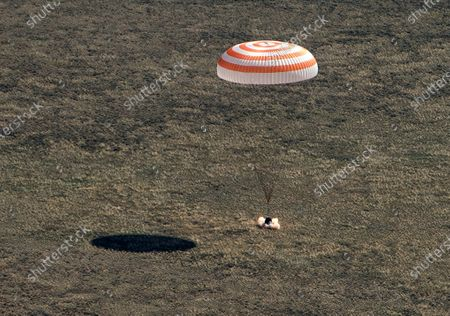 In this handout photo released by Gagarin Cosmonaut Training Centre (GCTC), Roscosmos space agency, The Soyuz MS-15 space capsule carrying International Space Station (ISS) crew members lands in a remote area near Kazakh town of Dzhezkazgan, Kazakhstan, . An International Space Station crew has landed safely after more than 200 days in space. The Soyuz capsule carrying NASA astronauts Andrew Morgan, Jessica Meir and Russian space agency Roscosmos' Oleg Skripochka touched down on Friday on the steppes of Kazakhstan. (Andrey Shelepin, Gagarin Cosmonaut Training Centre