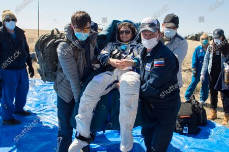 In this handout photo released by Gagarin Cosmonaut Training Centre (GCTC), Roscosmos space agency, rescue team members carry U.S. astronaut Jessica Meir shortly after the landing of the Russian Soyuz MS-15 space capsule near Kazakh town of Dzhezkazgan, Kazakhstan, . An International Space Station crew has landed safely after more than 200 days in space. The Soyuz capsule carrying NASA astronauts Andrew Morgan, Jessica Meir and Russian space agency Roscosmos' Oleg Skripochka touched down on Friday on the steppes of Kazakhstan. (Andrey Shelepin, Gagarin Cosmonaut Training Centre