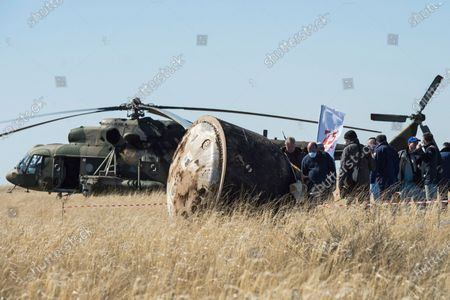 In this handout photo released by Gagarin Cosmonaut Training Centre (GCTC), Roscosmos space agency, a search and rescue team works on the site of landing of the Soyuz MS-15 space capsule near Kazakh town of Dzhezkazgan, Kazakhstan, . An International Space Station crew has landed safely after more than 200 days in space. The Soyuz capsule carrying NASA astronauts Andrew Morgan, Jessica Meir and Russian space agency Roscosmos' Oleg Skripochka touched down on Friday on the steppes of Kazakhstan. (Andrey Shelepin, Gagarin Cosmonaut Training Centre