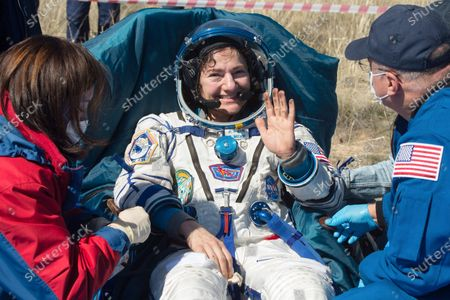 In this handout photo released by Gagarin Cosmonaut Training Centre (GCTC), Roscosmos space agency, U.S. astronaut Jessica Meir waves shortly after the landing of the Russian Soyuz MS-15 space capsule near Kazakh town of Dzhezkazgan, Kazakhstan, . An International Space Station crew has landed safely after more than 200 days in space. The Soyuz capsule carrying NASA astronauts Andrew Morgan, Jessica Meir and Russian space agency Roscosmos' Oleg Skripochka touched down on Friday on the steppes of Kazakhstan. (Andrey Shelepin, Gagarin Cosmonaut Training Centre