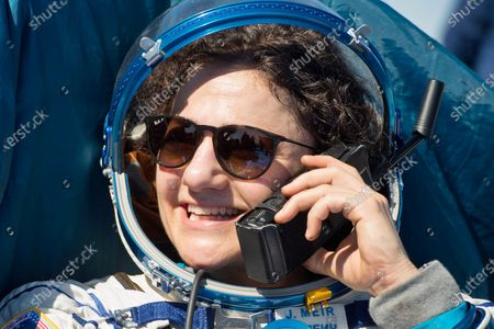 In this handout photo released by Gagarin Cosmonaut Training Centre (GCTC), Roscosmos space agency, U.S. astronaut Jessica Meir speaks phone with her relatives shortly after the landing of the Russian Soyuz MS-15 space capsule near Kazakh town of Dzhezkazgan, Kazakhstan, . An International Space Station crew has landed safely after more than 200 days in space. The Soyuz capsule carrying NASA astronauts Andrew Morgan, Jessica Meir and Russian space agency Roscosmos' Oleg Skripochka touched down on Friday on the steppes of Kazakhstan. (Andrey Shelepin, Gagarin Cosmonaut Training Centre