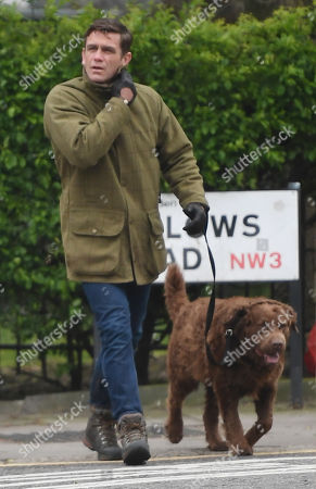 Stock Photo of Scott Maslen walking his dog