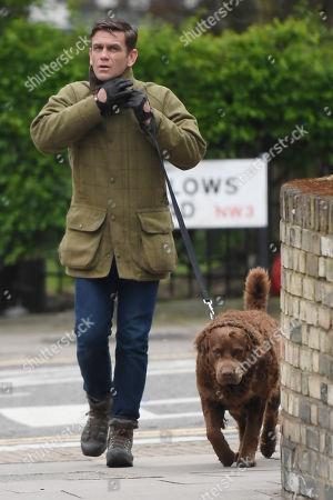 Stock Picture of Scott Maslen walking his dog