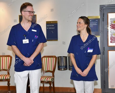 Princess Sofia (R), the Duchess of Vaermland, poses with male nurse Gustav Westboeoe (L), on her first day at work the at Sophiahemmet hospital, of which she is the patron, in Stockholm, Sweden, 16 April 2020 (issued 17 April 2020). Princess Sofia, wife of Swedish Prince Carl Philip, has completed an intensive care training program and will now be able to assist hospital staff with non-medical related tasks during the COVID-19 pandemic caused by the the SARS-CoV-2 coronavirus.