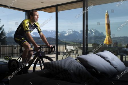 Editorial picture of Swiss cyclist Michael Albasini of Mitchelton-Scott team trains on bicycle rollers, Gais, Switzerland - 17 Apr 2020