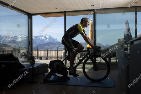 Swiss cyclist Michael Albasini of Mitchelton-Scott team trains on bicycle rollers in Gais, Switzerland, 17 April 2020. The organizers of the Tour de Suisse 2020 decided to cancel the  race due to the spread of the coronavirus and instead host the Digital Swiss 5 indoor cycling race which will compete on routes of the actual Tour de Suisse from 22 to 26 April 2020.