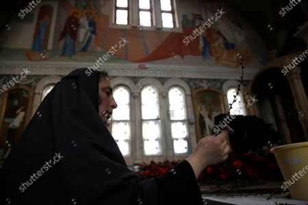 An Orthodox nun decorates a church with flowers at the Saint-Elizabeth's monastery on the Great Friday amid the ongoing pandemic of the COVID-19 disease caused by the SARS-CoV-2 coronavirus, as she prepares for the celebration of the Orthodox Easter at a nunnery on the outskirts of Minsk, Belarus, 17 April 2020. This year Orthodox Christians celebrate Easter on 19 April 2020.