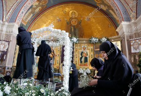 Orthodox nuns decorate a church with flowers at the Saint-Elizabeth's monastery on the Great Friday amid the ongoing pandemic of the COVID-19 disease caused by the SARS-CoV-2 coronavirus, as she prepares for the celebration of the Orthodox Easter at a nunnery on the outskirts of Minsk, Belarus, 17 April 2020. This year Orthodox Christians celebrate Easter on 19 April 2020.
