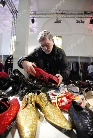 Stock Image of Adrian Perry Roberts looks at shoes