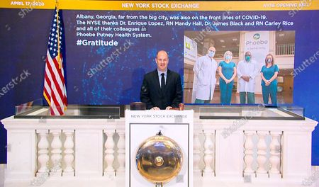 IMAGE DISTRIBUTED FOR THE NEW YORK STOCK EXCHANGE - On behalf of The New York Stock Exchange, Kevin Fitzgibbons, Chief Security Officer, rings The Opening Bell on in New York, to thank Dr. Enrique Lopez, RN Mandy Hall, Dr. James Black, and RN Carley Rice, of the Phoebe Putney Health System in Albany, Georgia. The NYSE joins millions of others who stand in awe and gratitude of the way people around the world have responded to the COVID-19 crisis - from medical professionals, to workers who ensure food supply, and those who keep streets safe. They honor some of those people through their #Gratitude campaign