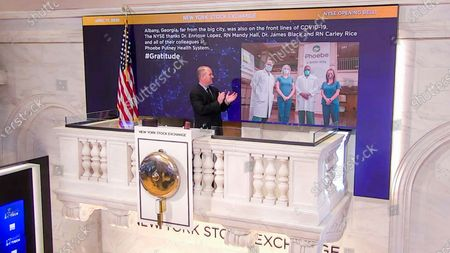 Stock Picture of IMAGE DISTRIBUTED FOR THE NEW YORK STOCK EXCHANGE - On behalf of The New York Stock Exchange, Kevin Fitzgibbons, Chief Security Officer, rings The Opening Bell on in New York, to thank Dr. Enrique Lopez, RN Mandy Hall, Dr. James Black, and RN Carley Rice, of the Phoebe Putney Health System in Albany, Georgia. The NYSE joins millions of others who stand in awe and gratitude of the way people around the world have responded to the COVID-19 crisis - from medical professionals, to workers who ensure food supply, and those who keep streets safe. They honor some of those people through their #Gratitude campaign
