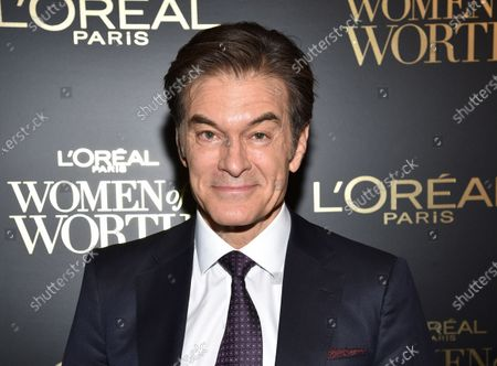 "Dr. Mehmet Oz at the 14th annual L'Oreal Paris Women of Worth Gala in New York. Oz says he misspoke during a Fox News Channel appearance this week where he said reopening schools was a ""very appetizing opportunity"" despite the coronavirus epidemic. In a Twitter post late Thursday, April 16, the heart surgeon and television talk show host said he recognized his comments had confused and upset people, and that was never his intention"