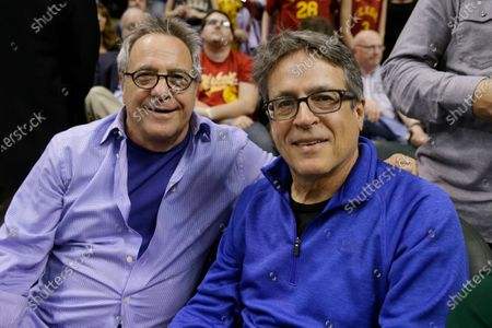 "Hoosiers"" director David Anspaugh, left, and writer Angelo Pizzo pose during an NBA basketball game between the Indiana Pacers and the Boston Celtics in Indianapolis. ""Hoosiers"" shot all the way to No. 1 in The Associated Press best sports movies Top 25"